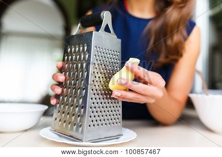 Young Woman Grating Ginger