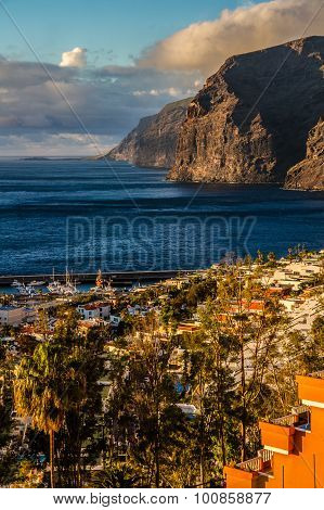 Los Gigantes And City During Sunset-tenerife,spain