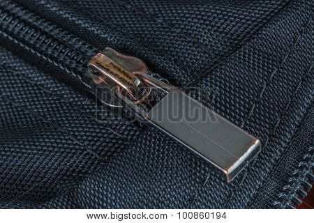 The Closed Zipper On Black Bag