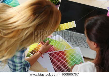 Hands Of Female Designer In Office Working With Colour Samples