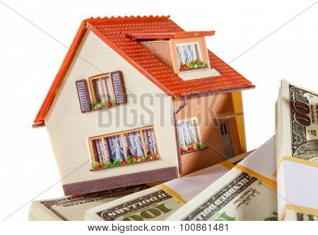 house on packs of banknotes isolated on white background