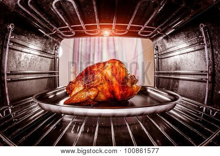 Roast chicken in the oven, view from the inside of the oven. Cooking in the oven. Thanksgiving Day.