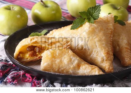 Homemade Turnover Pie With Apples And Raisins Close-up. Horizontal