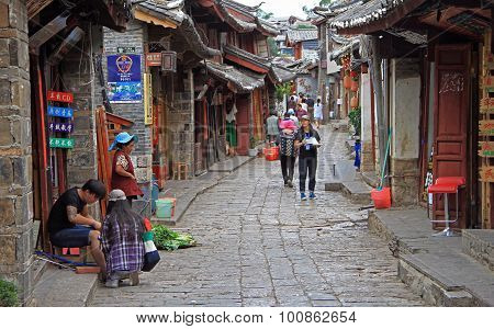people are walking on the street in Lijiang, China