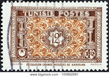 TUNISIA - CIRCA 1947: Stamp shows Arabesque Ornamentation from Great Mosque at Kairouan
