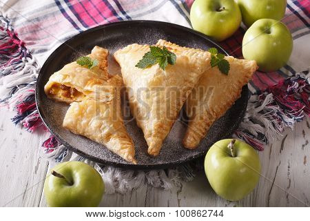 Turnover Pie With Apples Close Up On A Plate. Horizontal