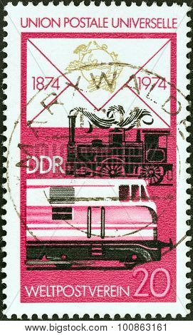 GERMAN DEMOCRATIC REPUBLIC - CIRCA 1974: Stamp shows Steam and diesel railway locomotives