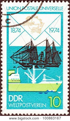 GERMAN DEMOCRATIC REPUBLIC - CIRCA 1974: Stamp shows James Watt (paddle steamer), Modern Freighter