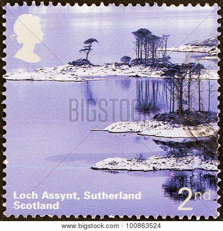 UNITED KINGDOM - CIRCA 2003: A stamp printed in United Kingdom shows Loch Assynt, Sutherland