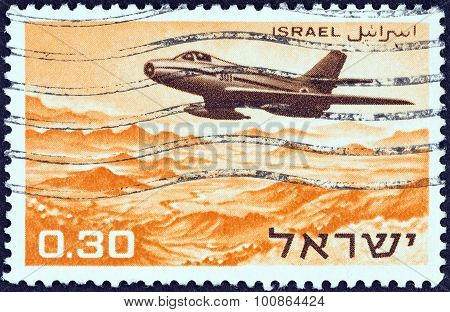 ISRAEL - CIRCA 1967: Stamp shows Dassault MD.454 Mystere IVA flying over the Dead Sea area