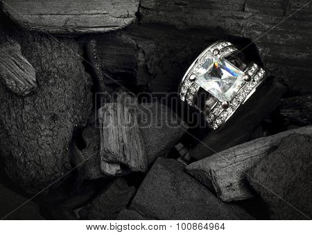 Jewelry Ring Witht Big Colourful Diamond On Black Coal Background