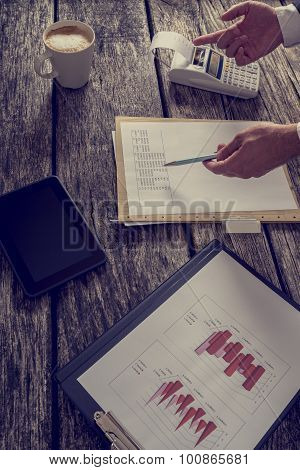Financial Business Adviser Or Accountant Reviewing And Checking Annual Tax Report