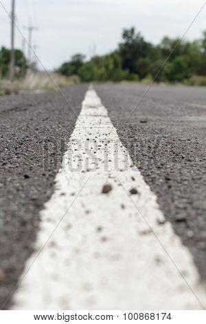 White Line On Asphalt Road Close Up