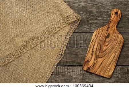 Wood chopping board on wooden background
