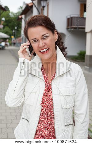 Smiling Businesswoman On Phone Calls With Your Cell Phone