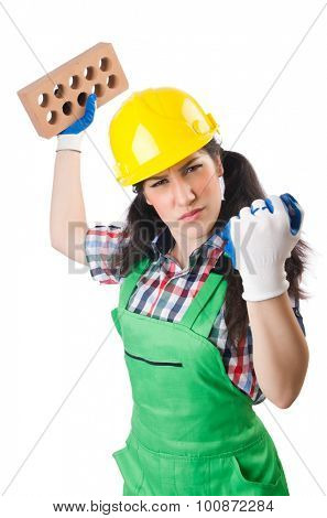 Female workman in green overalls holding brick isolated on white