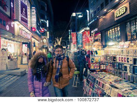 People Walk Around Shopping Street In Seoul, South Korea