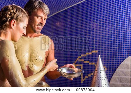 Couple at Rasul bath in wellness spa