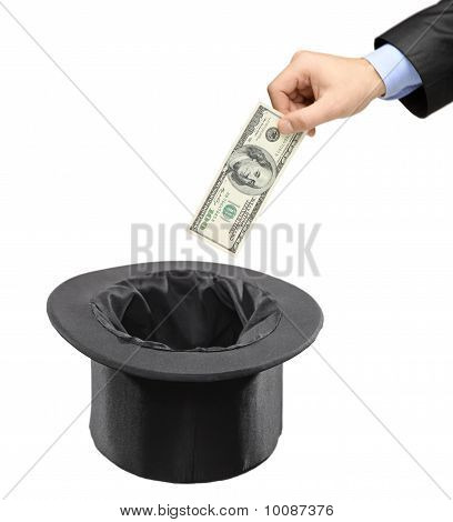 Man Inserting A Dollar Into A Black Hat
