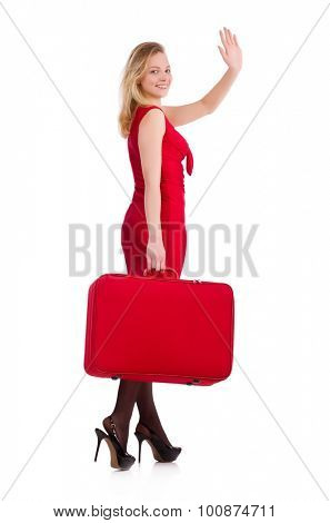 Smiling woman in red dress with suitcase isolated on white