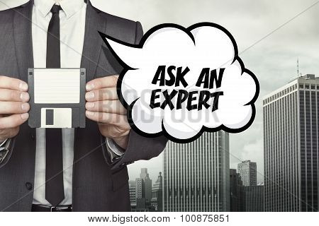Ask an expert text on speech bubble with businessman holding diskette