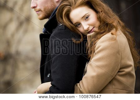 Young Red Hair Couple At Autumn Park