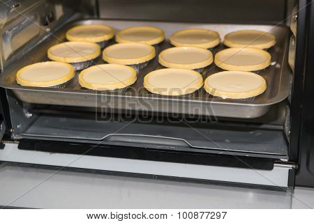 Egg Tarts About To Be Cooked In The Oven
