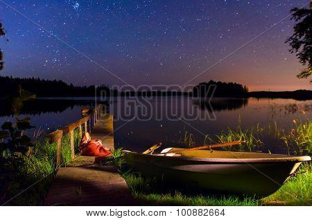 serene starry night on the coast of Finnish lake