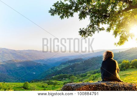 scenic view of woman watching at sunset mountains, Peneda-Geres National Park, northern Portugal.