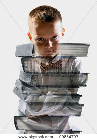confident school boy mixed with pile of books, isolated on white background