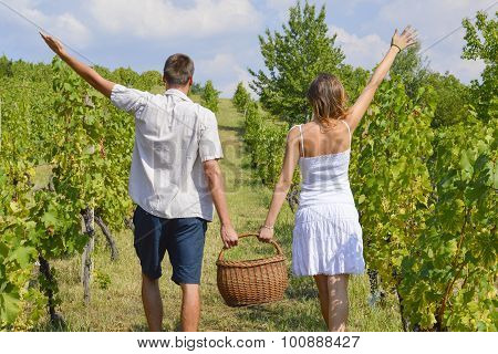 Brother And Sister Working On Grape Picking And Holding The Basket