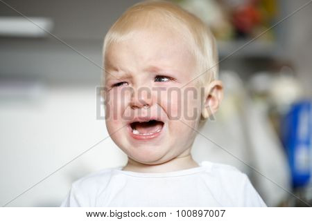 Small And Sick Crying Toddler In Pain