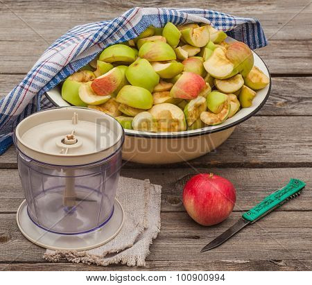Sliced Apple Jam In A Bowl Next To The Mixer