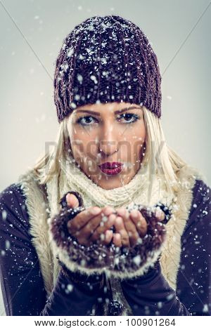 Cute Girl Blowing Snowflakes