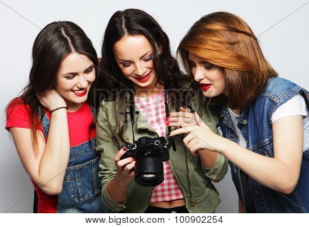 three young girls looking at camera, studio shot