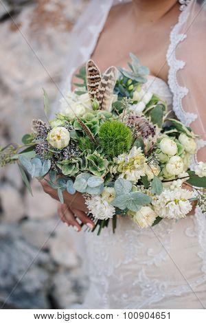 Bride With Wedding Bouquet In Hand