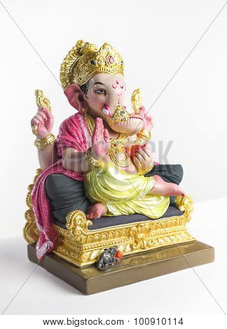 Colorful statue of Ganesha idol. Side view on white background.