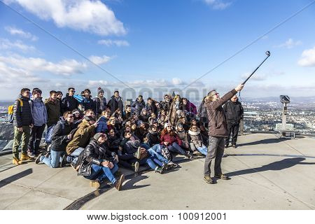 Group Of People Poses At Top Of The Main Tower Skyscraper