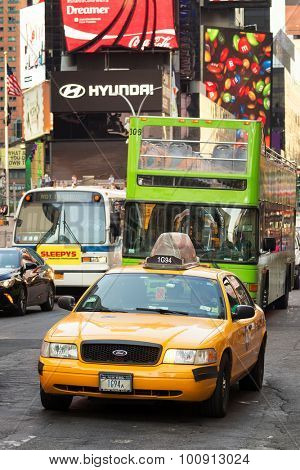 NEW YORK,USA- AUGUST 14,2015 : An iconic New York Yellow cab at Times Square in downtown Manhattan
