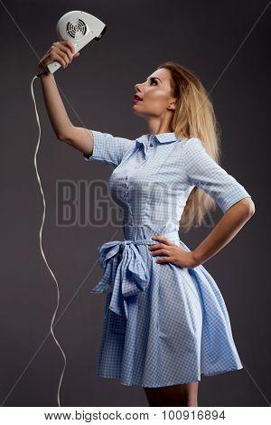 Blonde Girl Using Hair Dryer.