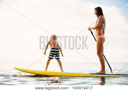 Mother and Son Stand Up Paddling Together Having Fun in the Ocean