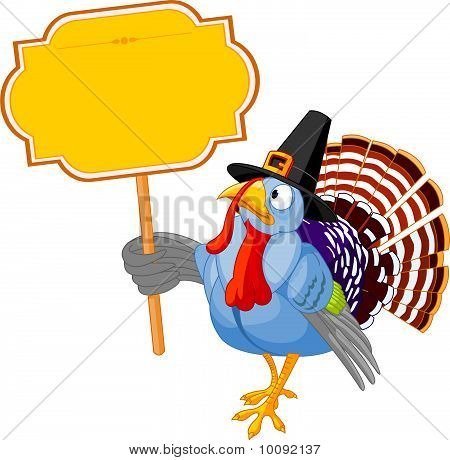 Turkey Holding A Blank Board Sign
