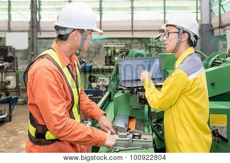 Asian Mechanical Engineer Using Computer-aided To Do Planning And Control Equipment In Factory
