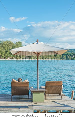 Summer, Travel, Vacation And Holiday Concept - Tourist Sleeping In Chair Beach At Luxury Resort, Phu
