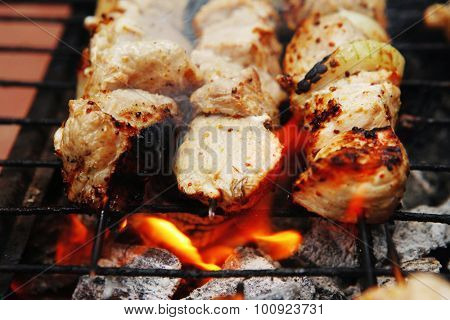 ready to eat smoked fresh hot grilled chicken shish kebab barbecue on grid over charcoal