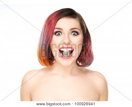Attractive excited girl with colored hair having candy in mouth.