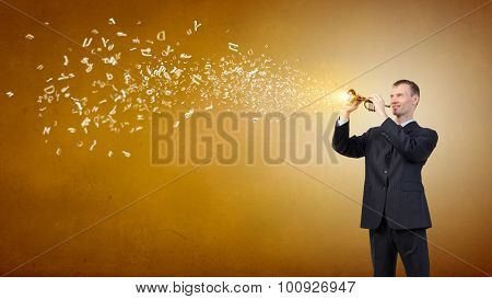 Young businessman in black suit playing flute