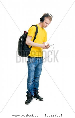Teenage boy listening to the music isolated on white