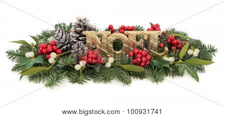 Christmas display with gold noel sign, holly, mistletoe, ivy, pine cones and winter greenery over white background.