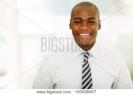 cheerful african american entrepreneur in modern office